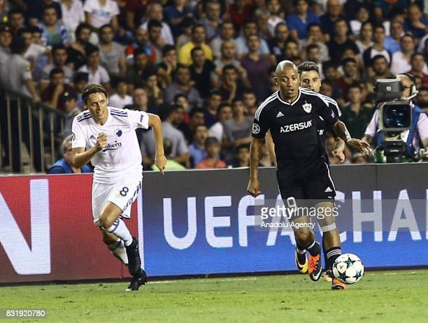 Dino Ndlovu of Qarabag Agdam in action against Uros Matic of FC Copenhagen during the UEFA Champions League playoff match between Qarabag Agdam and...
