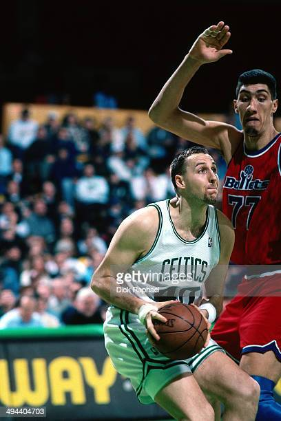 Dino Radja Boston Celtics goes goes up for the shot against Gheorghe Murean of the Washington Bullets during a game played in 1995 at the Boston...