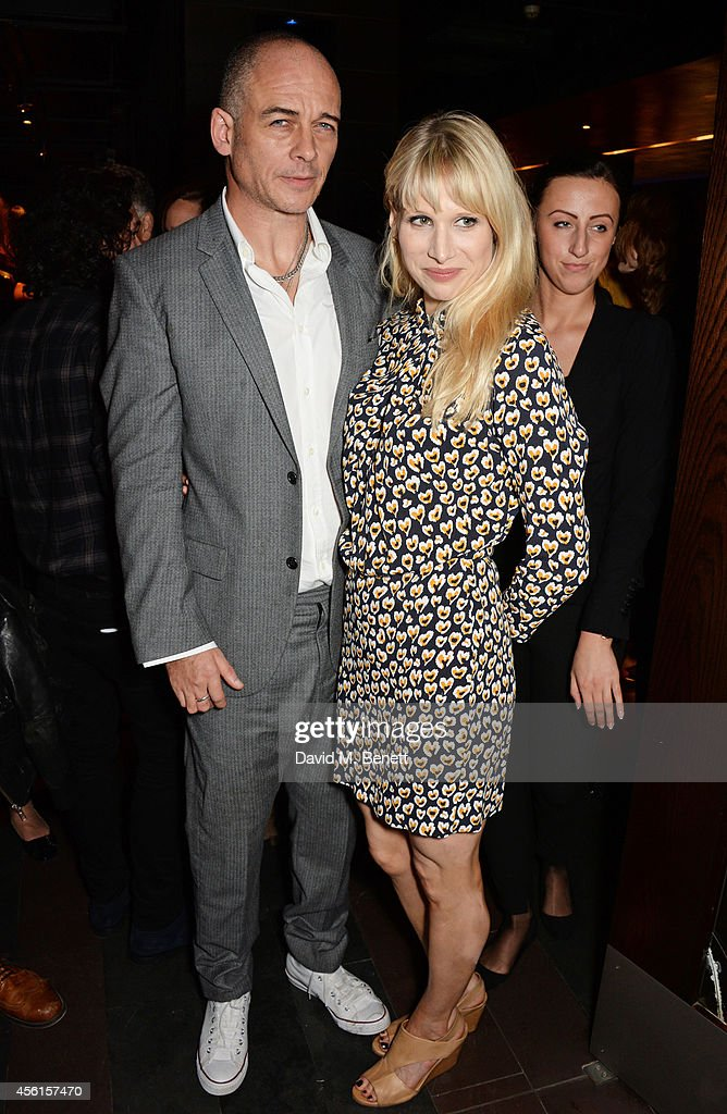 Dinos Chapman (L) and Lucy Punch attend the press night performance of 'Great Britain' following its transfer to the Theatre Royal Haymarket at Mint Leaf on September 26, 2014 in London, England.