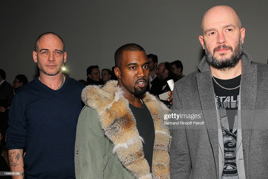 Dinos Chapman, Kanye West and Jake Chapman attend the Louis Vuitton Men Autumn / Winter 2013 show as part of Paris Fashion Week on January 17, 2013 in Paris, France.