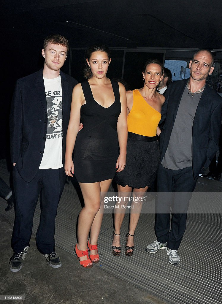 Dinos Chapman, Tiphaine de Lussy, Seraphine Chapman and guest arrive at the Warner Music Group Pre-Olympics Party in the Southern Tanks Gallery at the Tate Modern on July 26, 2012 in London, England.