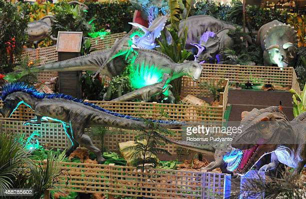 Dinosaur replicas are displayed in the Dinosaur Adventure and Learning Experience Park at Tunjungan Plaza on September 15 2015 in Surabaya Indonesia...