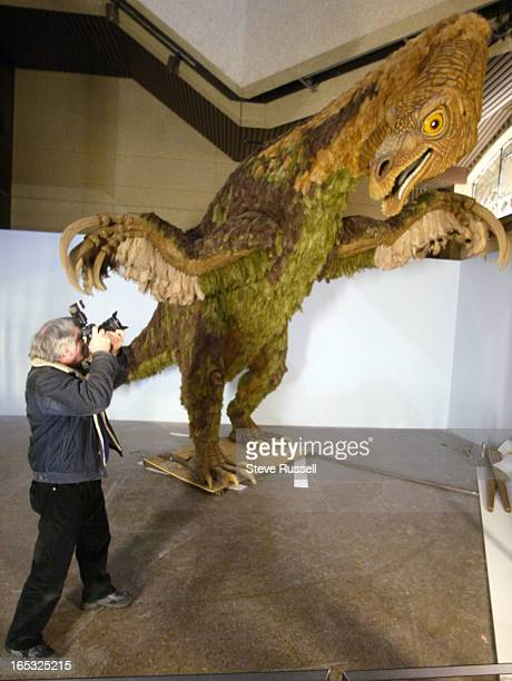DINOSAURS03/01/05Etobicoke Guardian photographer Dennis Hanagan sneaks in for a photo of a 14foot tall model of the Therizinosaurus at the Royal...