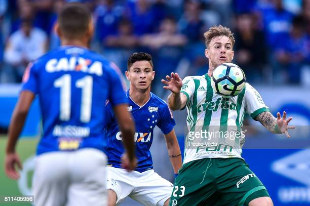 Diogo Barbosa of Cruzeiro and Roger Guedes of Palmeiras battle for the ball during a match between Cruzeiro and Palmeiras as part of Brasileirao...