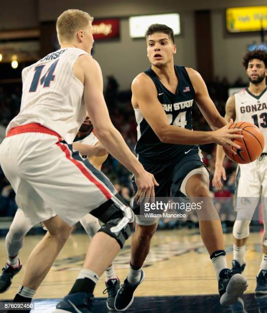 Diogo Brito of the Utah State Aggies drives against Jacob Larsen of the Gonzaga Bulldogs in the second half at McCarthey Athletic Center on November...