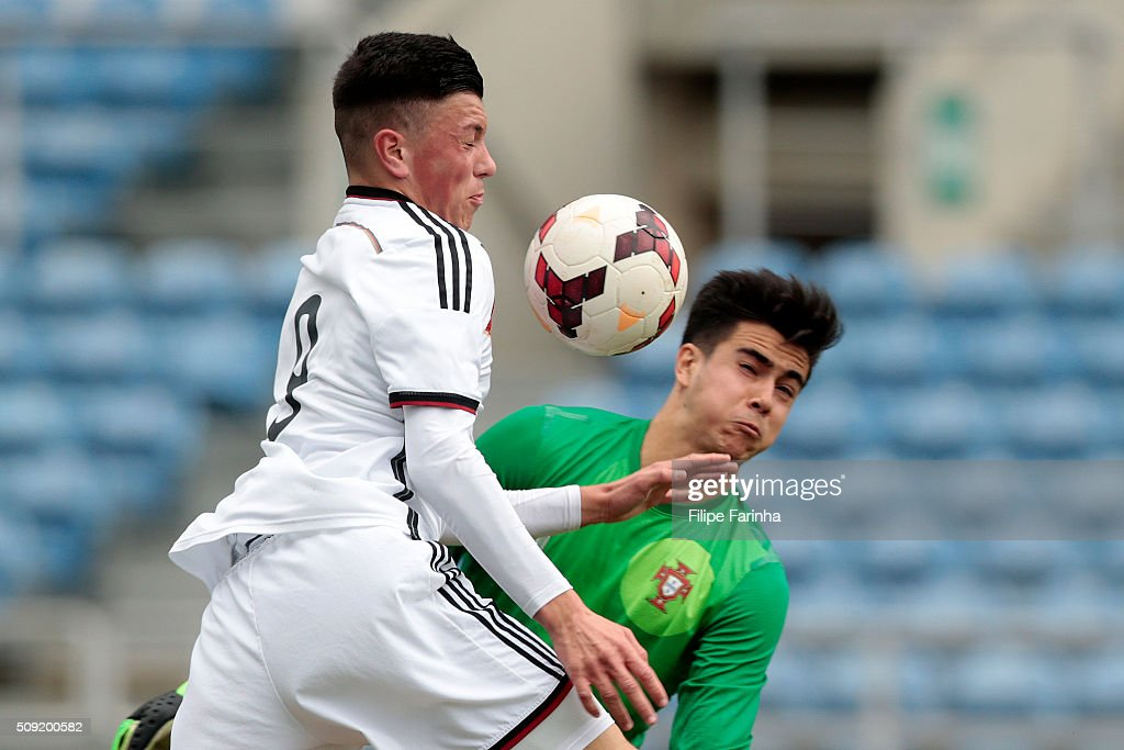 Diogo Costa of Portugal challenges Renat Dadashov of Germany during the UEFA Under17 match between U17 Portugal v U17 Germany on February 9, 2016 in Estádio Algarve, Loulé, Portugal.