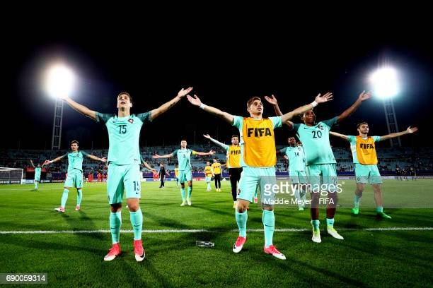 Diogo Dalot of Portugal and Andre Ribeiro lead their team in celebration after defeating Korea Republic 31 in the FIFA U20 World Cup Korea Republic...