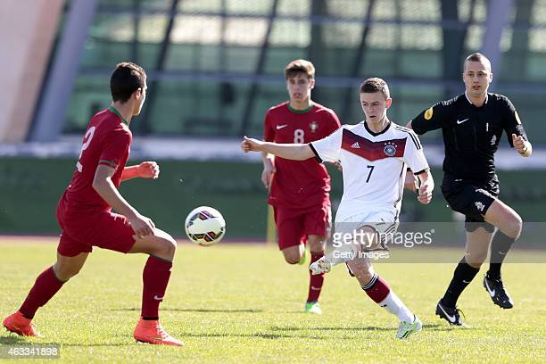 Diogo Dalot of Portugal challenges Dominik Wanner of Germany during the U16 Algarve Cup match between Germany and Portugal on February 12 2015 in...