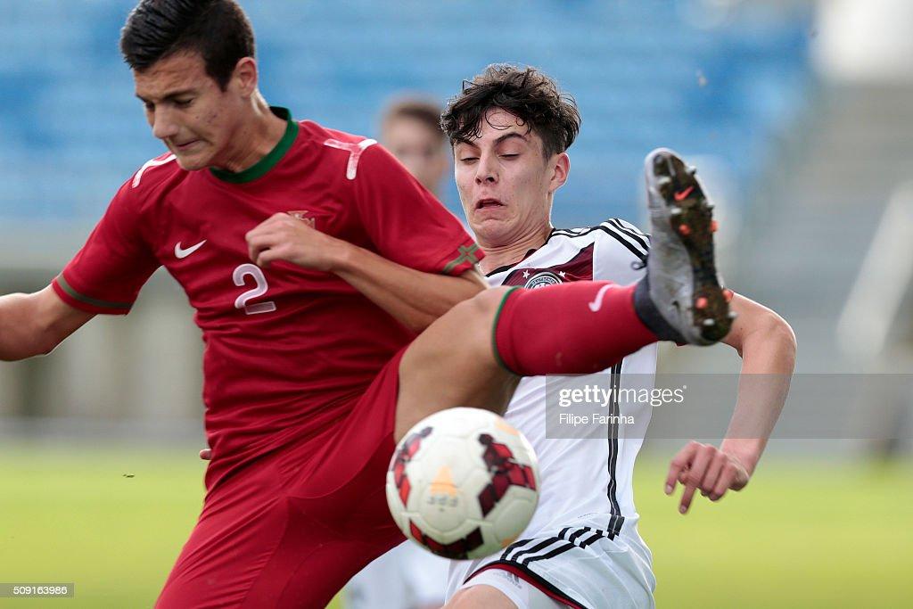 Diogo Dalot of Portugal challenges Kai Havertz of Germany during the UEFA Under17 match between U17 Portugal v U17 Germany on February 9, 2016 in Estádio Algarve, Loulé, Portugal.