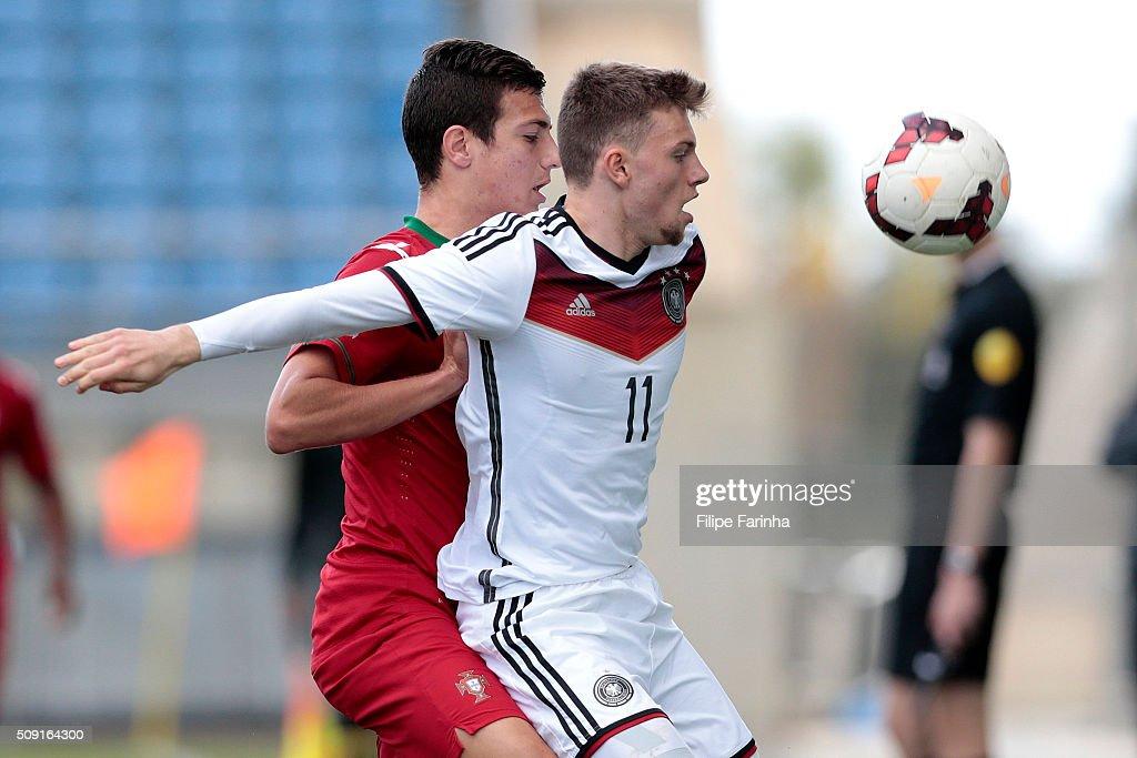 Diogo Dalot of Portugal challenges Manuel Wintzheimer of Germany during the UEFA Under17 match between U17 Portugal v U17 Germany on February 9, 2016 in Estádio Algarve, Loulé, Portugal.