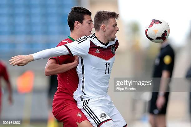 Diogo Dalot of Portugal challenges Manuel Wintzheimer of Germany during the UEFA Under17 match between U17 Portugal v U17 Germany on February 9 2016...