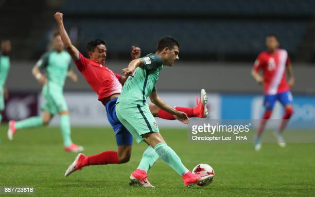 Diogo Dalot of Portugal clears as Barlon Sequeira of Costa Rica dives in during the FIFA U20 World Cup Korea Republic 2017 group C match between...