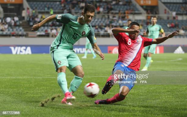 Diogo Dalot of Portugal clears as Jimmy Marin of Costa Rica dives in during the FIFA U20 World Cup Korea Republic 2017 group C match between Costa...
