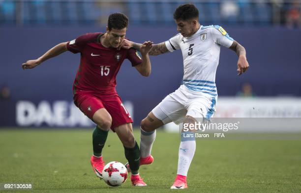 Diogo Dalot of Portugal is challenged by Mathias Olivera of Uruguay during the FIFA U20 World Cup Korea Republic 2017 Quarter Final match between...