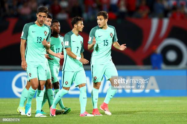 Diogo Dalot of Portugal talks with Diogo Goncalves and Jorge Fernandes during the FIFA U20 World Cup Korea Republic 2017 Round of 16 match between...