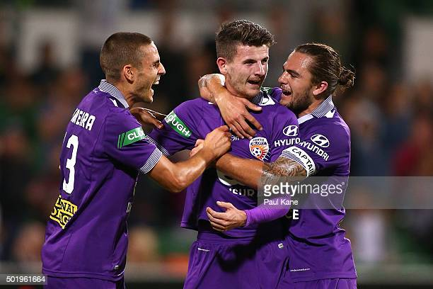 Diogo Ferreira and Josh Risdon of the Glory congratulate Mitchell Oxborrow after scoring from a free kick during the round 11 ALeague match between...