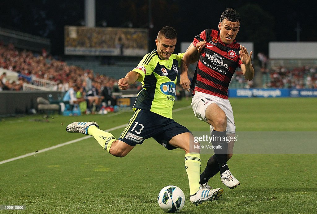Diogo Ferreira of the Victory takes on Mark Bridge of the Wanderers during the round eight A-League match between the Western Sydney Wanderers and the Melbourne Victory at Parramatta Stadium on November 24, 2012 in Sydney, Australia.