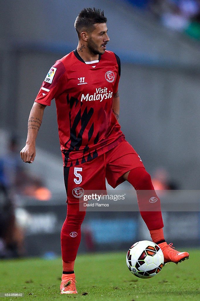 Diogo Figueiras of Sevilla FC runs with the ball during the La Liga Match between RCD Espanyol and Sevilla FC at Cornella-El Prat Stadium on August 30, 2014 in Barcelona, Spain.