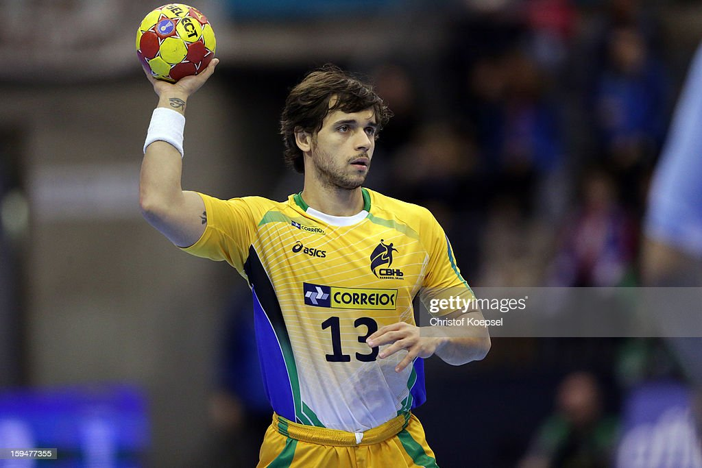Diogo Hubner of Brazil passes the ball during the premilary group A match between Brasil and Argentina and Montenegro at Palacio de Deportes de Granollers on January 13, 2013 in Granollers, Spain.
