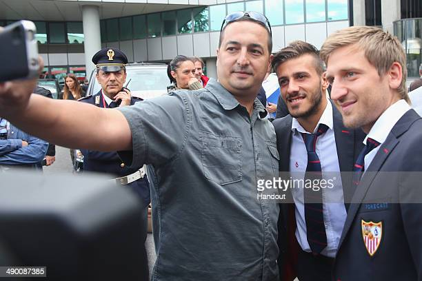 Diogo José Rosário Gomes Figueiras of Sevilla FC arrives with his team mate Markus Marin at the Turin airport Sandro Pertini with his wife Melanie...