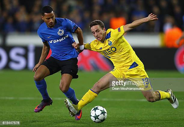 Diogo Jota of FC Porto and Ricardo van Rhijn of Club Brugge compete for the ball during the UEFA Champions League Group G match between Club Brugge...
