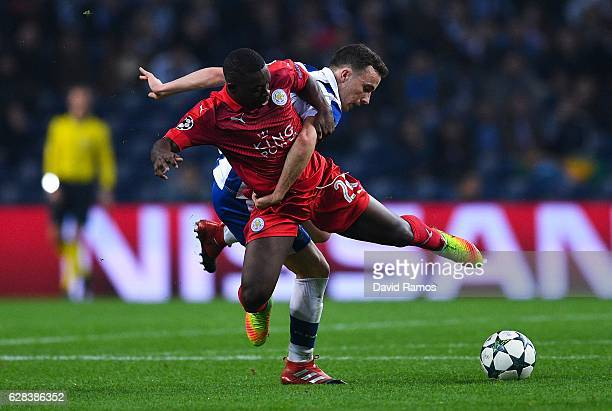 Diogo Jota of FC Porto competes for the ball with Nampalys Mendy of Leicester City FC during the UEFA Champions League match between FC Porto and...