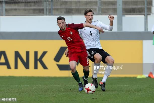 Diogo Jota of Portugal und Niklas Stark of Germany battle for the ball during the International Friendly match between Germany U21 and Portugal U21...