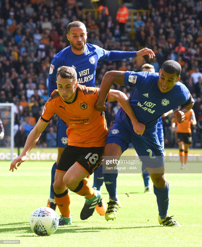 Diogo Jota of Wolverhampton Wanderers and Lee Peltier of Cardiff City during the Sky Bet Championship match between Wolverhampton and Cardiff City at Molineux on August 19, 2017 in Wolverhampton, England.