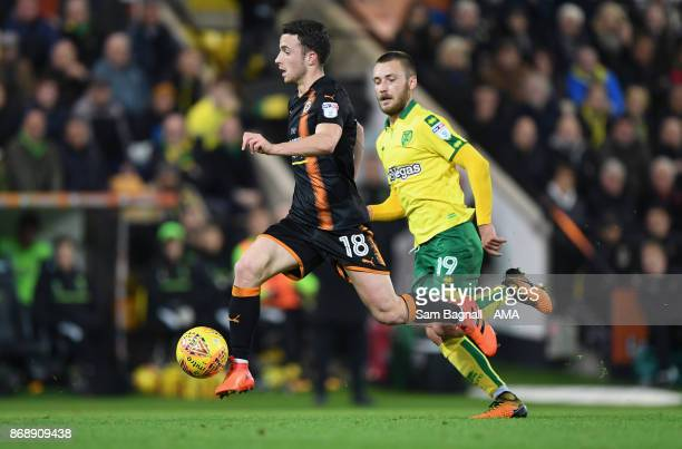 Diogo Jota of Wolverhampton Wanderers and Tom Trybull of Norwich City during the Sky Bet Championship match between Norwich City and Wolverhampton at...