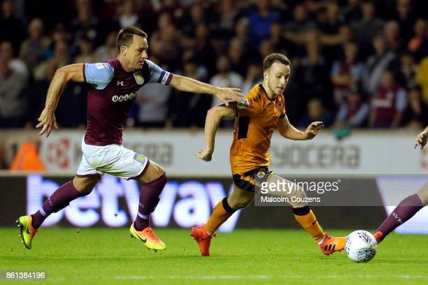 Diogo Jota of Wolverhampton Wanderers competes with John Terry of Aston Villa during the Sky Bet Championship match between Wolverhampton and Aston...