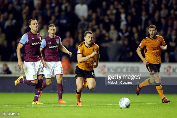Diogo Jota of Wolverhampton Wanderers gets past John Terry and James Chester of Aston Villa John Terry of Aston Villa during the Sky Bet Championship...