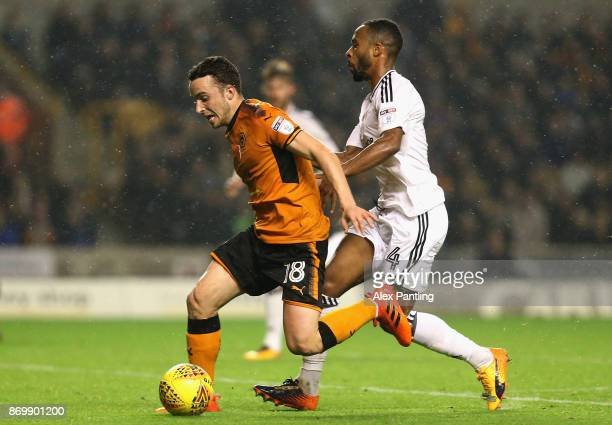Diogo Jota of Wolverhampton Wanderers holds off Denis Odoi of Fulham during the Sky Bet Championship match between Wolverhampton Wanderers and Fulham...