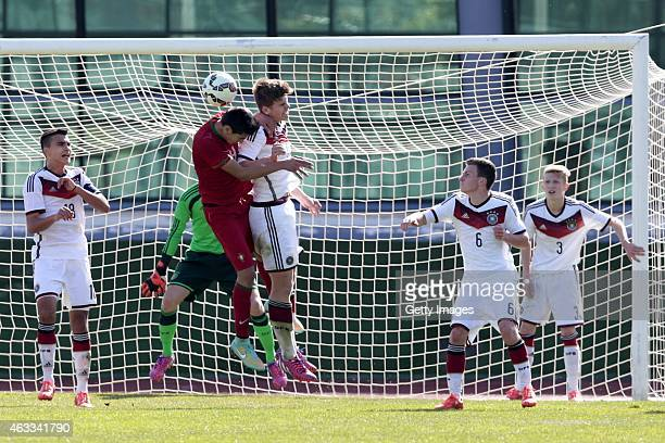 Diogo Leite of Portugal challenges Florian Baak of Germany during the U16 Algarve Cup match between Germany and Portugal on February 12 2015 in Vila...
