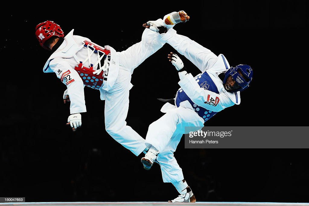 Diogo Silva of Brazil competes against Mohammad Bagheri Motamed of Iran during the Men's 68kg Taekwondo semifinal match on Day 13 of the London 2012...
