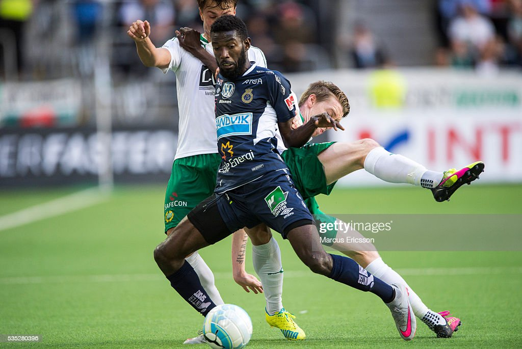 Dioh Williams of Gefle IF fighting over the ball with Melker Hallberg and Birkir Mar Saevarsson of Hammarby IF during the Allsvenskan match between Hammarby IF and Gefle IF at Tele2 Arena on May 29, 2016 in Stockholm, Sweden.