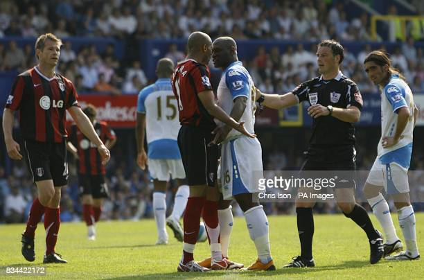 Diomansy Kamara Fulham and Noe Pamarot Portsmouth face up to each other as referee Mark Clattenburg steps in