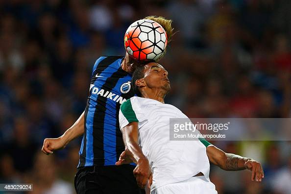 Dion Cools of Club Brugge leaps above Jose Carlos Goncalves Zeca of Panathinaikos and heads the ball to score his teams first goal of the game past...