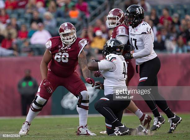Dion Dawkins of the Temple Owls blocks Marquise Copeland of the Cincinnati Bearcats at Lincoln Financial Field on October 29 2016 in Philadelphia...