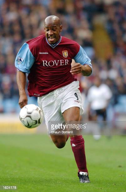 Dion Dublin of Aston Villa makes a break forward during the FA Barclaycard Premiership match between Aston Villa and Fulham on November 9 2002 played...