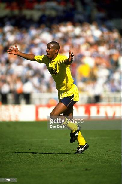 Dion Dublin of Cambridge United celebrates after scoring during the Barclays League Fourth Division playoff against Chesterfield at the Abbey Stadium...