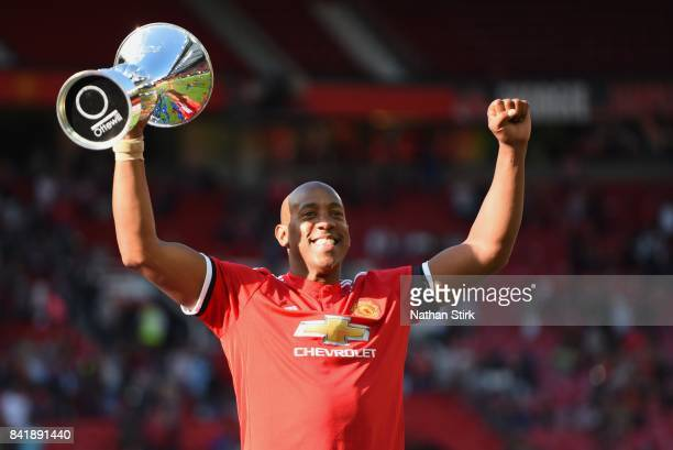 Dion Dublin of Manchester United celebrates with the trophy during the match between Manchester United Legends and FC Barcelona Legends at Old...