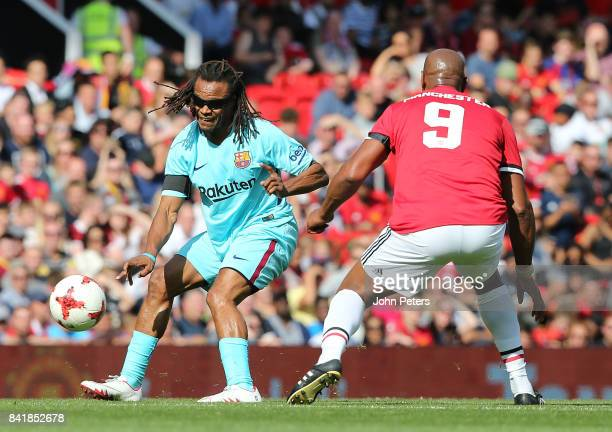 Dion Dublin of Manchester United Legends in action with Edgar Davids of Barcelona Legends during the MU Foundation charity match between Manchester...