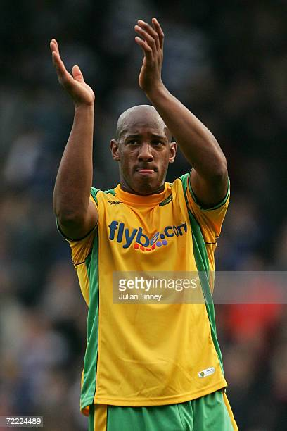 Dion Dublin of Norwich City applauds the travelling fans after the CocaCola Championship match between Queens Park Rangers and Norwich City at Loftus...