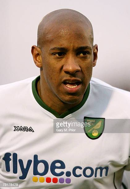 Dion Dublin of Norwich City looks on during the FA Cup sponsored by EON Fourth Round match between Blackpool and Norwich City at Bloomfield Road on...