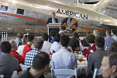 Dion Flannery president and chief executive officer of PSA Airlines Inc speaks to attendees at the American Airlines Inc Flight Training Center...