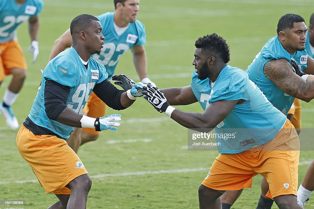 <a gi-track='captionPersonalityLinkClicked' href=/galleries/search?phrase=Dion+Jordan&family=editorial&specificpeople=6161243 ng-click='$event.stopPropagation()'>Dion Jordan</a> #95 and <a gi-track='captionPersonalityLinkClicked' href=/galleries/search?phrase=Terrence+Fede&family=editorial&specificpeople=12849843 ng-click='$event.stopPropagation()'>Terrence Fede</a> #78 of the Miami Dolphins participate in drills during the teams first OTA on May 27, 2014 at the Miami Dolphins training facility in Davie, Florida.