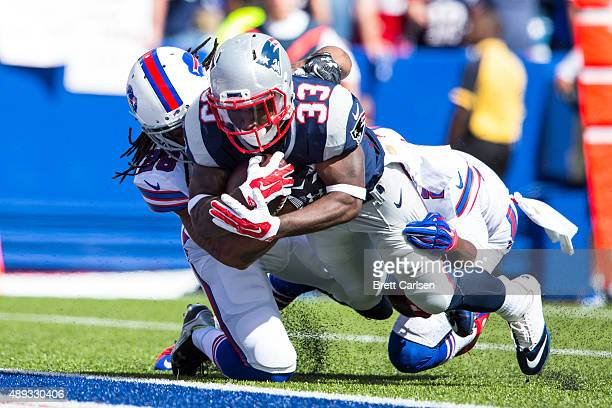 Dion Lewis of the New England Patriots dives in for a touchdown making the score 147 over Buffalo Bills during the first quarter on September 20 2015...