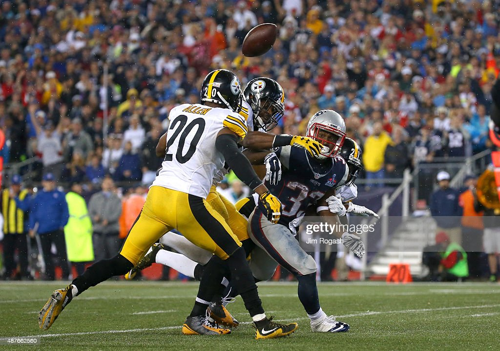 Dion Lewis #33 of the New England Patriots has the ball stripped by Mike Mitchell #23 of the Pittsburgh Steelers in the second half at Gillette Stadium on September 10, 2015 in Foxboro, Massachusetts.