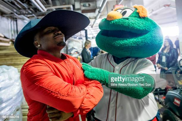 Dion Lewis of the New England Patriots is greeted by Boston Red Sox mascot Wally before a pregame ceremony before the Boston Red Sox home opener...