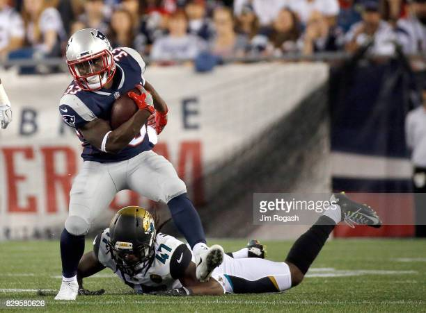 Dion Lewis of the New England Patriots runs in the first half of a preseason game against the Jacksonville Jaguars at Gillette Stadium on August 10...